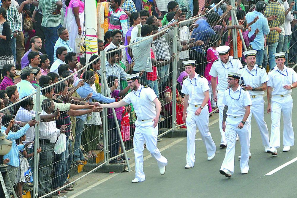 Foreign Navy personnel greet the crowd.