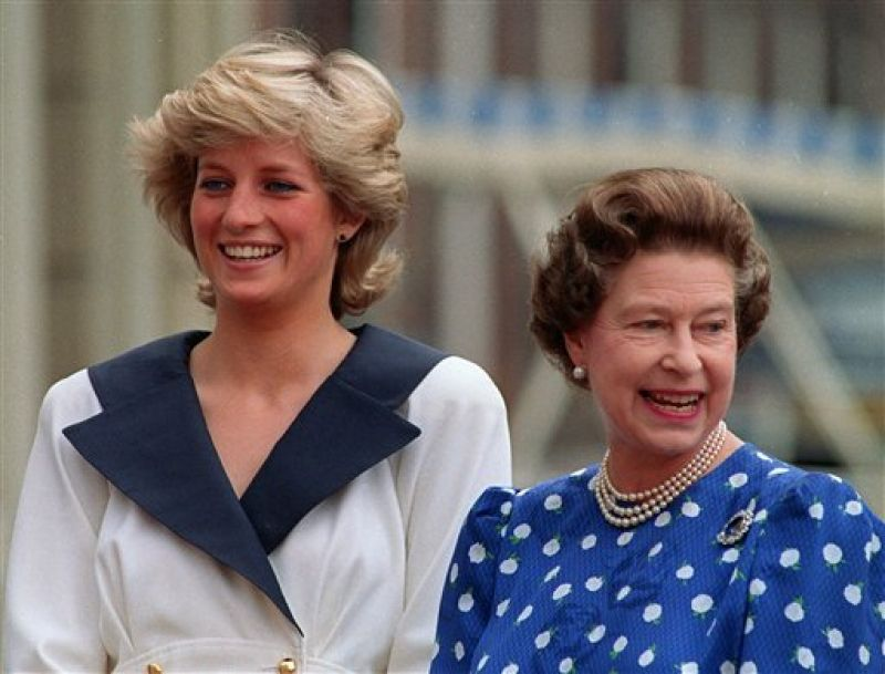 In this file photo, Diana, Princess of Wales, left, and Britain's Queen Elizabeth II smile to well-wishers outside Clarence House in London. (Photo: AP)