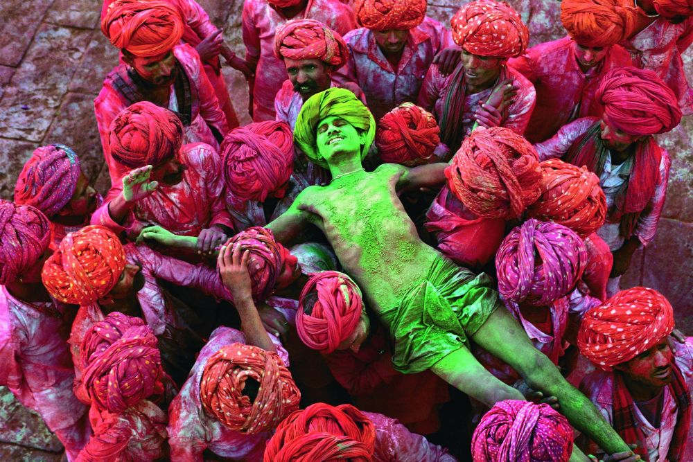 Crowd carries a man during the Holi festival, Rajasthan, 1996