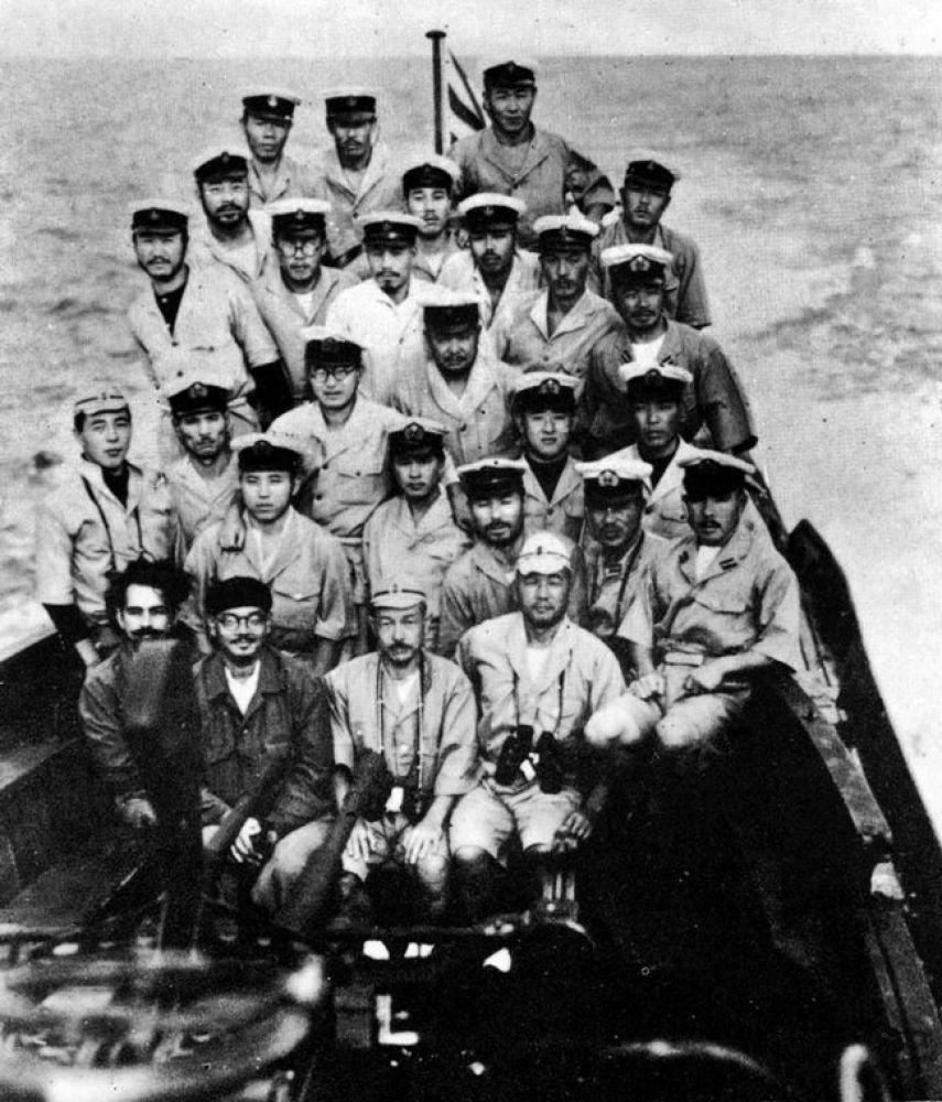 At sea: Bose, in front row, with the crew of Japanese submarine  I-29 after the rendezvous with German submarine U-180 300, near Madagascar.