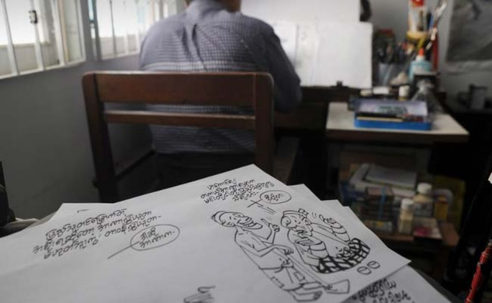 Now cartoons are enjoying a renaissance, tackling a range of subjects - from the country's economic woes to foreign policy and the elections -peppering newspapers and websites daily. (Photo: AFP)