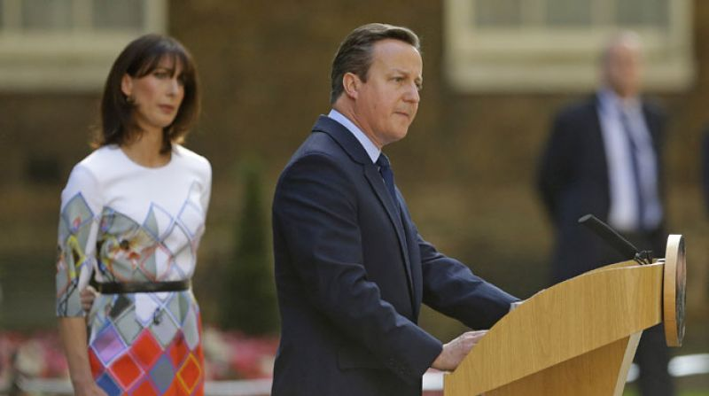 Britain's Prime Minister David Cameron speaks outside 10 Downing Street, London as his wife Samantha looks on Friday. (Photo: AP)