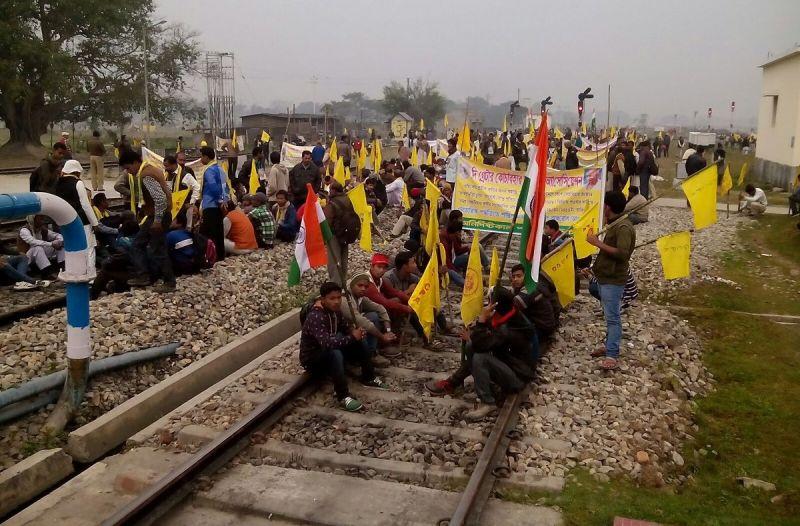 Protestors sit on railway tracks in Cooch Behar. (Photo: ANI/Twitter)