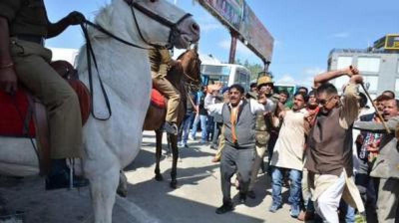 BJP MLA Ganesh Joshi attacking Shaktimaan during a protest rally. (Photo: File)