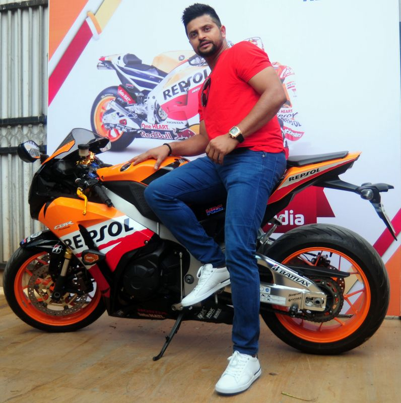 Suresh Raina looked cool with a red t-shirt at the the launch of a petroleum lubricant on Tuesday. (Photo: Debasish Dey/DC)