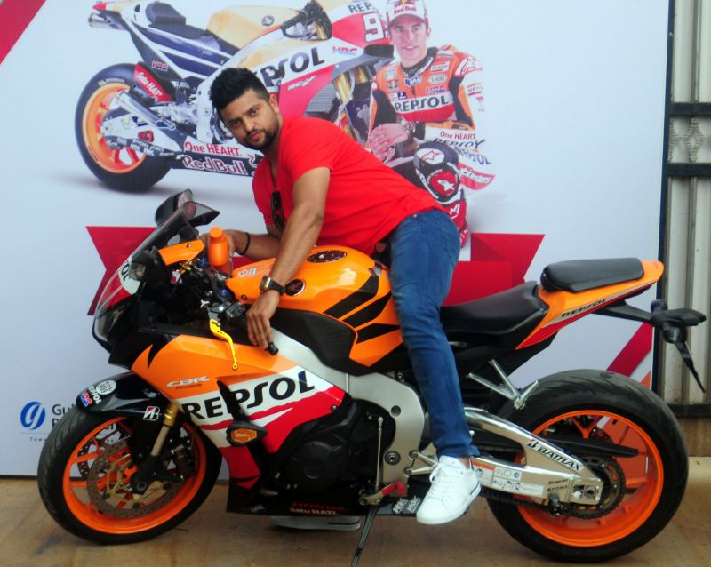Suresh Raina poses with a sportsbike during the launch of a petroleum lubricant on Tuesday. (Photo: Debasish Dey/DC)