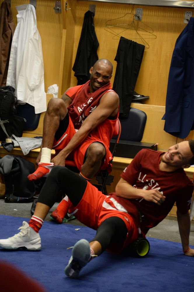 Kobe Bryant shares a lighter moment in the dressing room. (Photo: NBA Entertainment)
