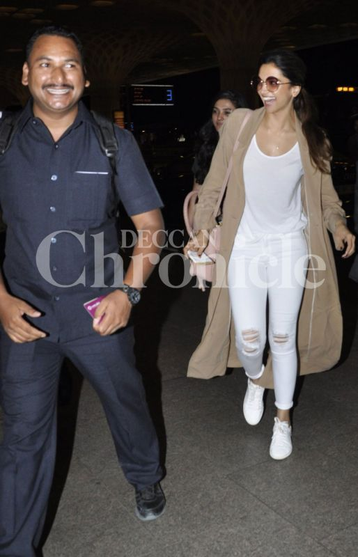 Deepika Padukone and her bodyguard had a hearty laugh on their way in to the airport.