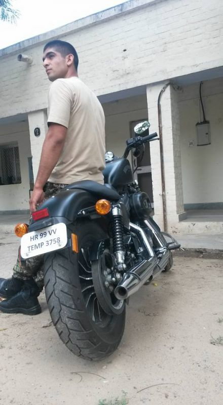 Capt. Pawan Kumar posing with a motorbike. (Photo: Facebook)