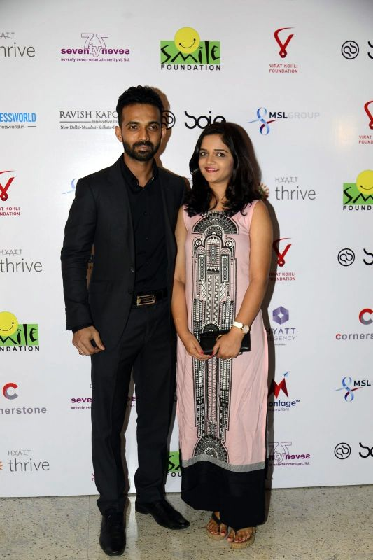 Ajinkya Rahane with wife Radhika pose for the shutterbugs before the event.