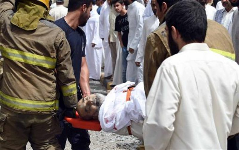 A wounded man is helped moments after a deadly explosion claimed by the Islamic State group during Friday prayers at the Imam Sadiq Mosque in Kuwait City. (Photo: AP)