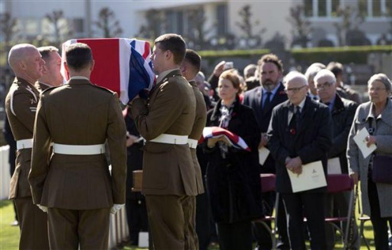 British Army Artillery prepare to lower the casket of WWI British soldier Gunner Albert Willam Venus during a burial ceremony.