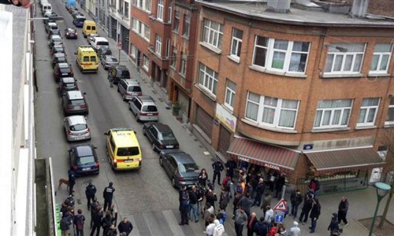 Emergency vehicles travel along a street blocked by armed police officers during a raid in the Molenbeek neighborhood of Brussels, Belgium. (Photo: AP)