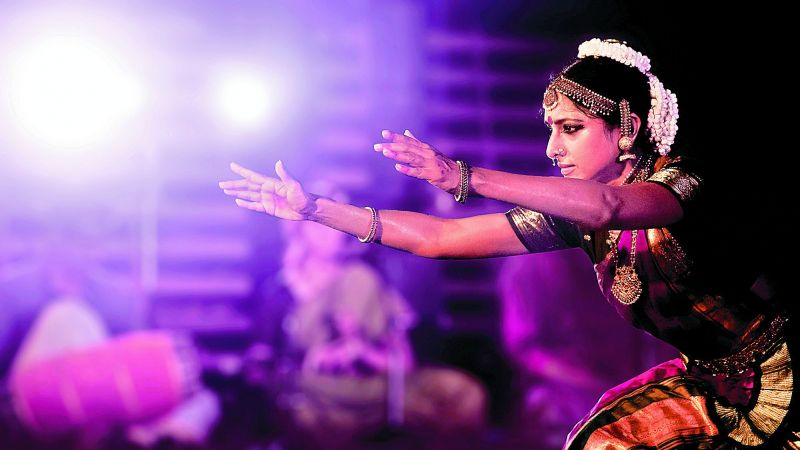 """(Above) """"Oh Krishna, come closer to me...,"""" says the nayika as Meenakshi Sreenivasan translates the mood effectively to the audience; (below) What if there is an argument between Lakshmi and Parvathi over their husbands? Here is Parvathy Sreevallabhan and Sandra Pisharody, young Mohiniyattam danseuses, role playing the Goddesses."""