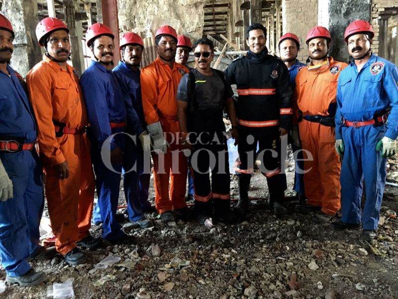 Randeep Hooda poses with a group of real firemen.
