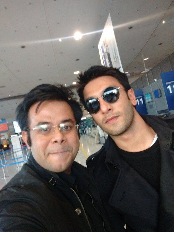 Ranveer Singh poses with a fan.