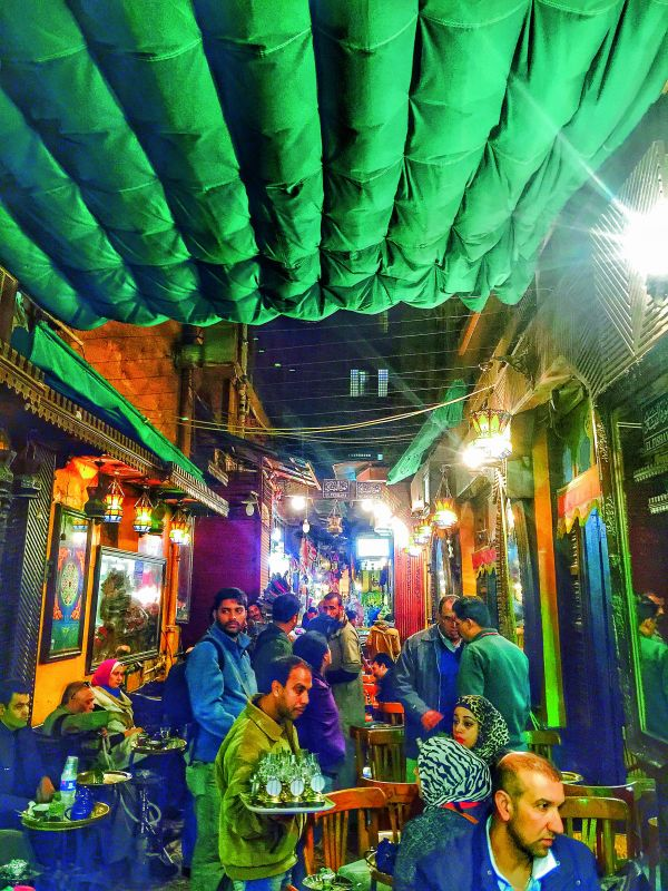 People unwinding at El Fishawy coffee shop in Old Cairo