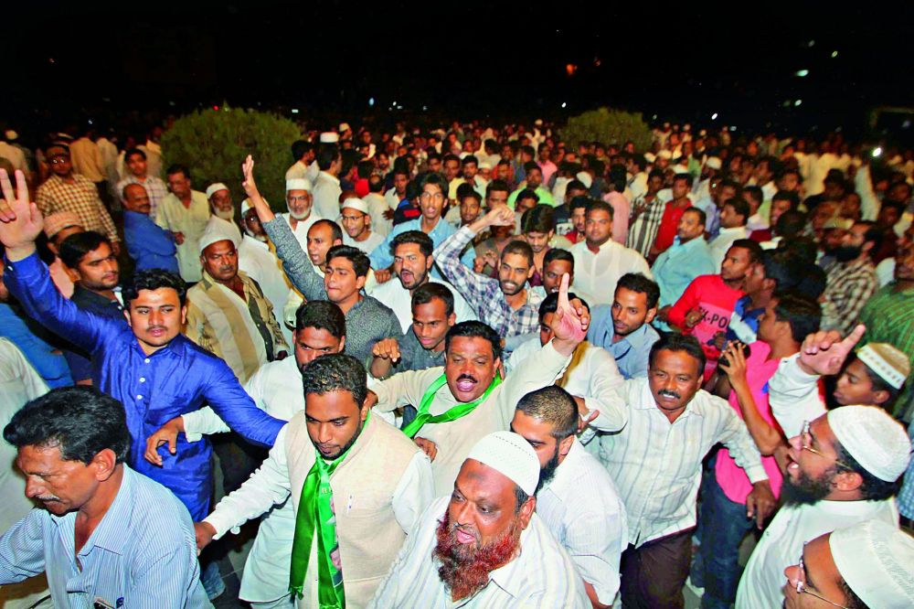 MIM party workers celebrating the party's victory in the Old City on Friday. (Photo: DC)
