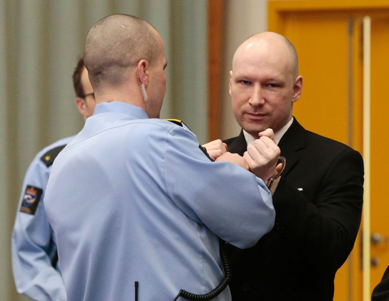 With a dark suit and shaved head, Breivik was led into the gym-turned-courtroom in the prison, where the trial is being held for security reason. (Photo: AFP)