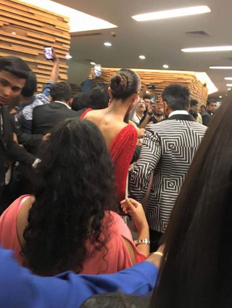 Ranveer and Deepika photographed walking arm-in-arm back stage.