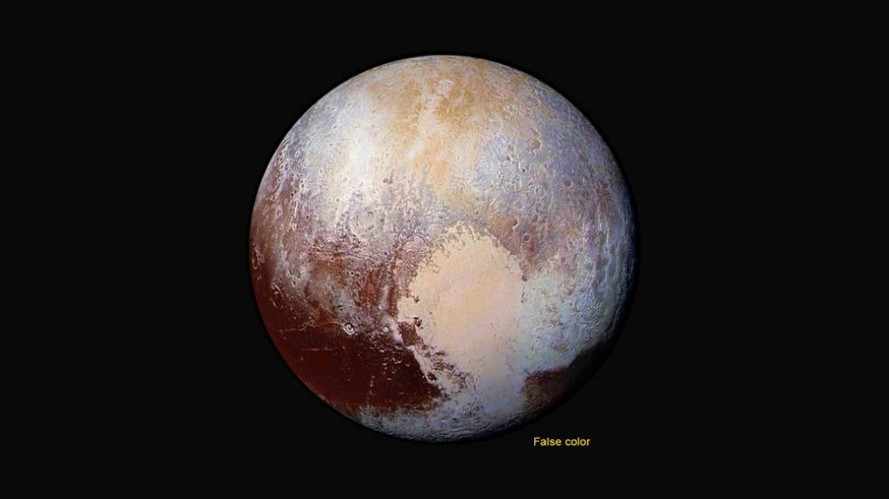 Four images from New Horizons' Long Range Reconnaissance Imager (LORRI) were combined with color data from the Ralph instrument to create this enhanced color global view of Pluto (Photo: NASA)
