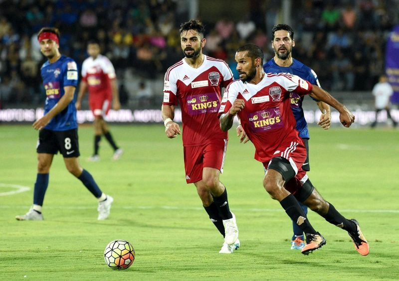 It was a treat to watch Virat Kohli and Shikhar Dhawan showing off their skills in football. (Photo: PTI)
