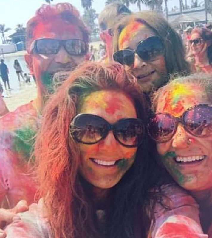 Preity and her mother Nilprabha Zinta pose for a photo at the Holi party.