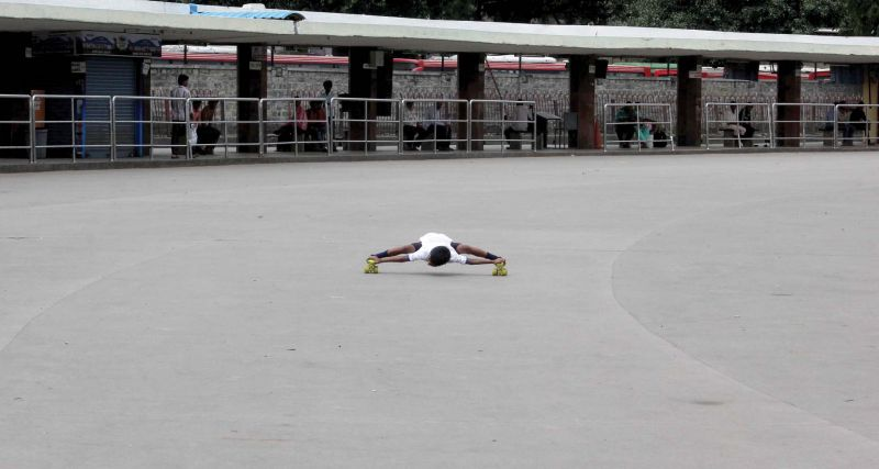 A limbo skater shows his skills at the deserted Majestic bus stand in city on Friday. (Photo: DC)