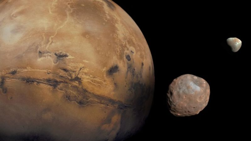 Mars and its two moons - Phobos and Demios.