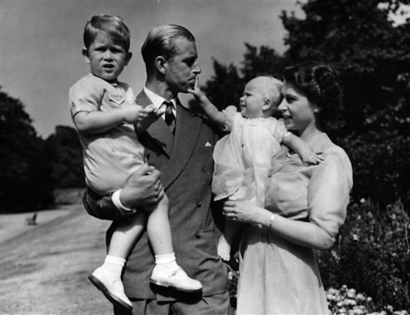 Princess Elizabeth stands with her husband Prince Philip, the Duke of Edinburgh, and their children Prince Charles and Princess Anne at the couple's London residence. (Photo: AP/File)