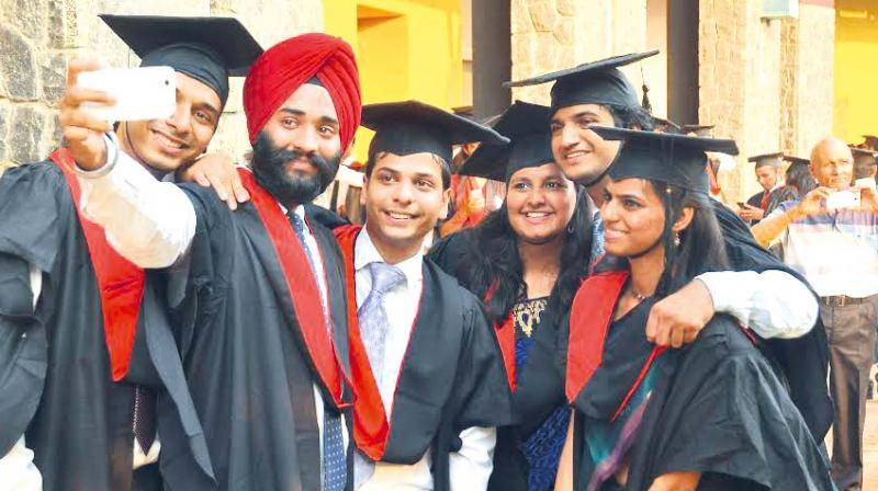 Postgraduates of Indian Institute of Management-Kozhikode take selfies during the convocation ceremony on Saturday at the campus. (Photo: Venugopal)