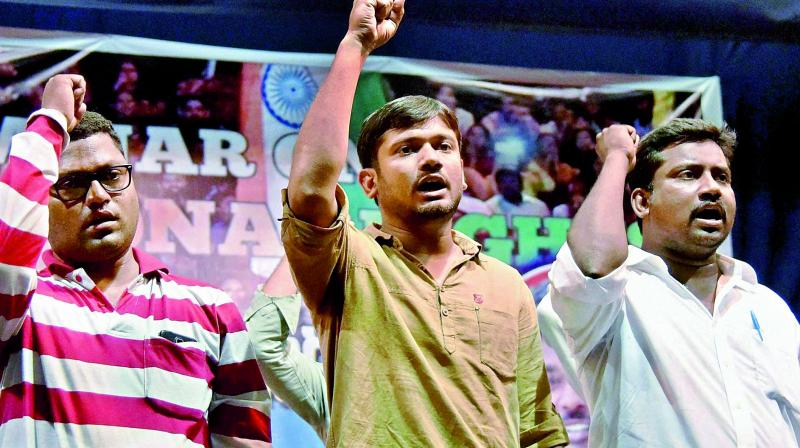 JNU students' union president Kanhaiya Kumar along with other student representatives shout slogans at a seminar on Constitution rights in Hyderabad on Thursday. (Photo: PTI)