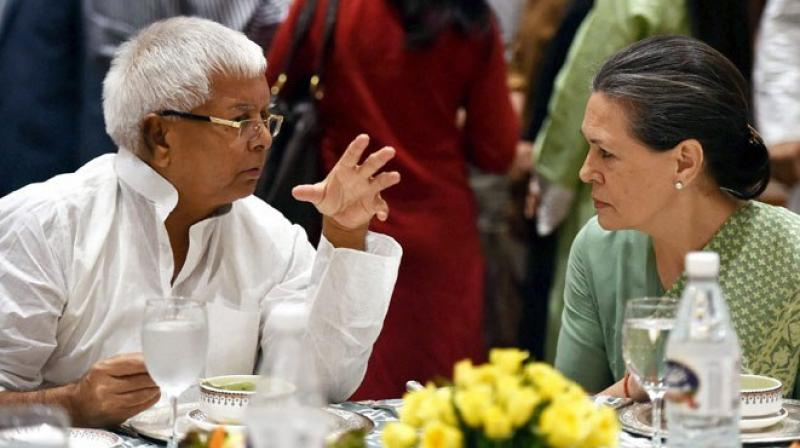 Lalu Prasad Yadav and Sonia Gandhi (Photo: PTI)
