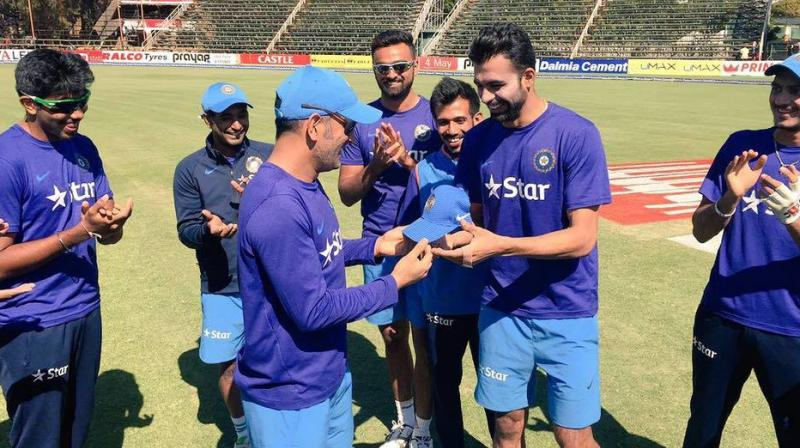 Barinder Sran was delighted to receive his maiden India T20 and ODI caps from captain Mahendra Singh Dhoni. (Photo: BCCI)