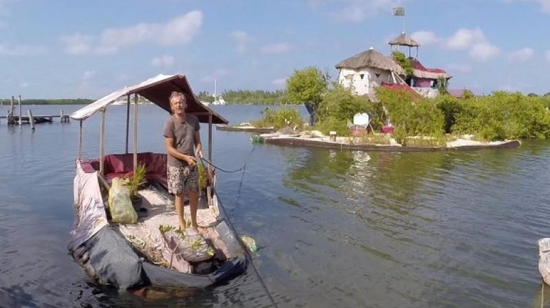 Richart Sowa took seven years to create the island using 150,000 recycled plastic bottles. (Credit: YouTube)