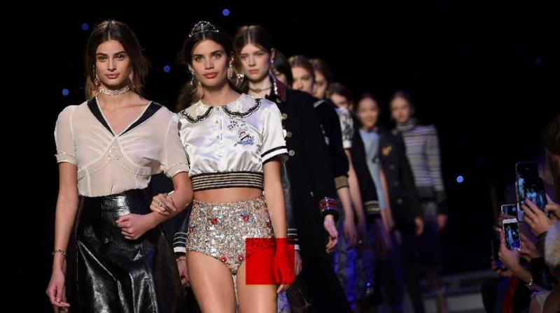Models present creations by Tommy Hilfiger during the Fall 2016 New York Fashion Week, on February 15, 2016. (Photo: AFP)
