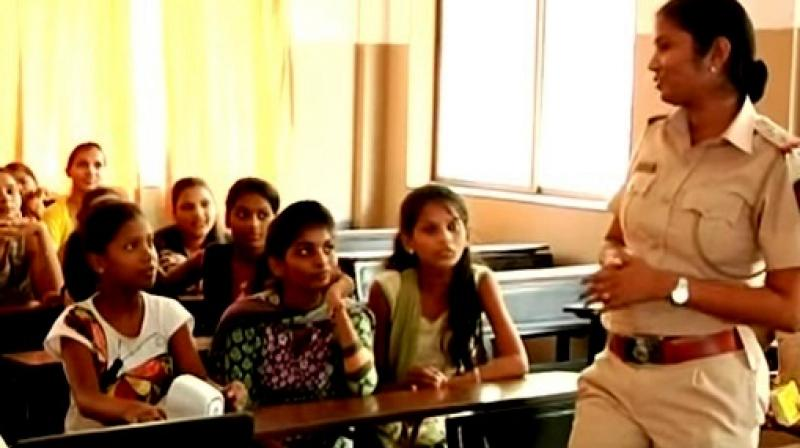 Female police stations reach out to girls in slums (Photo: YouTube)
