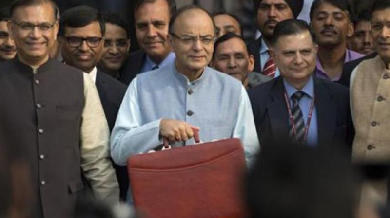 Finance Minister Arun Jaitley along with his budget team leave from North Block to meet President. (Photo: PTI)