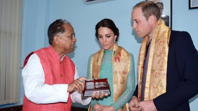 Prince William, Duke of Cambridge and his wife Catherine (Kate), Duchess of Cambridge being presented with a Monumental Statue of Historical Shiv Dol and Ranghor by Chief Minister of Assam Tarun Gogoi. (Photo: PTI)