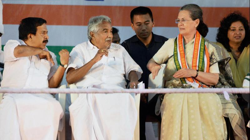 Congress President Sonia Gandhi with Kerala Chief Minister Oommen Chandy during an the rally in Thiruvananthapuram. (Photo: PTI)