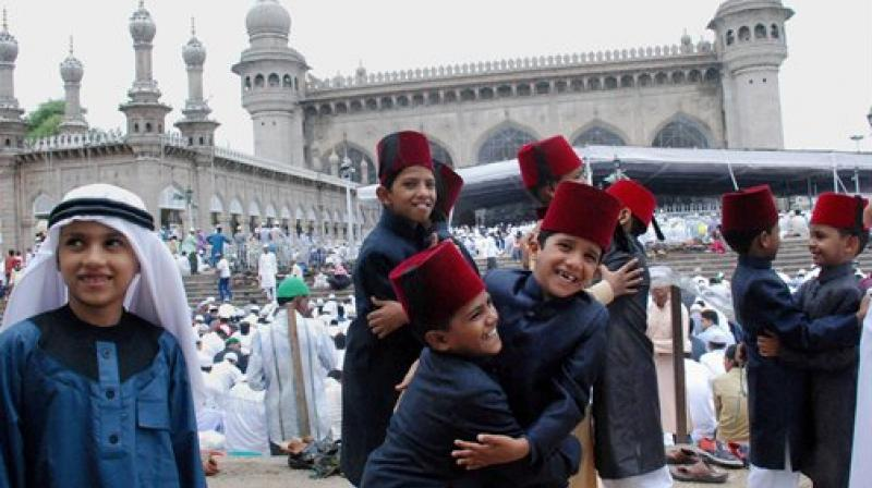 Muslim kids greet each other after the Eid Al Fitr prayers at historic Makkah Masjid in Hyderabad. (Photo: PTI)