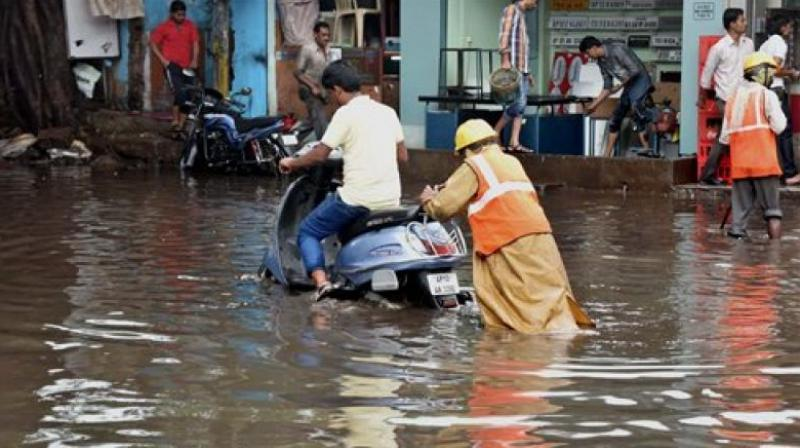 Meanwhile, Union minister Venkaiah Naidu on Tuesday undertook an aerial survey of the flood-hit parts of Guntur district. (Photo: PTI)