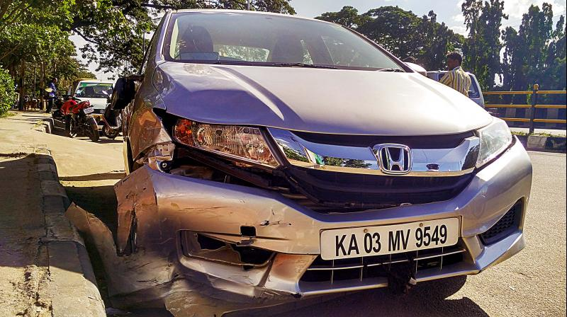 Honda City car that was involved in a serial accident on Nandidurga Road on Sunday evening	(Photo: DC)