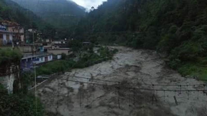 A large number of homes in the Laswa area of the Valley were damaged and dozens of people were swept away in the flooding caused by relentless rainfall after the cloudburst over night. (Photo: Twitter)