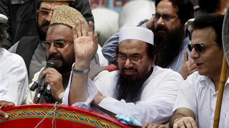 File photo of Hafiz Saeed, leader of a Pakistani religious group waves during an anti-India rally in Lahore, Pakistan. (Photo: AP)