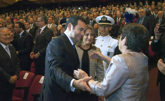 Guatemalan new President Jimmy Morales is congratulated by his mother Celia Cabrera during his inauguration ceremony in Guatemala City. (Photo: AFP)