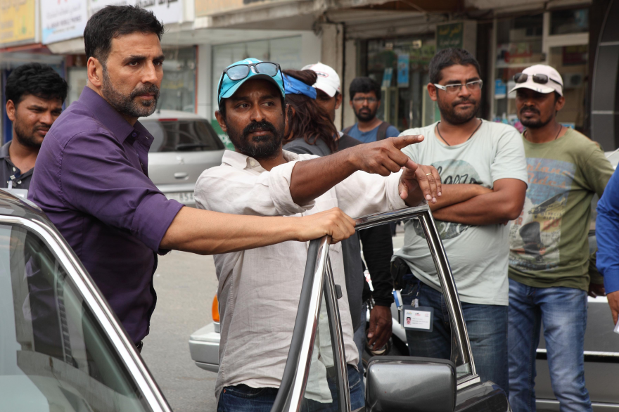 Director Raja Menon on the sets of 'Airlift' explaining a shot to his lead actor Akshay Kumar.