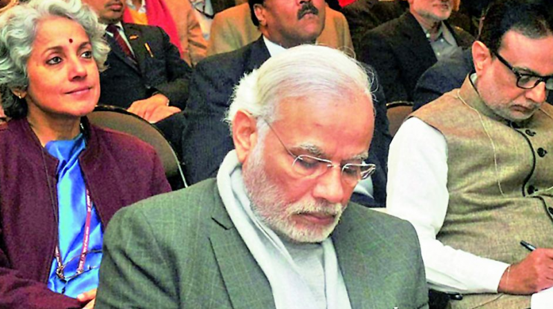 Prime Minister Narendra Modi takes notes as Group of Secretaries present their ideas on Swachh Bharat, Shikshit Bharat, in Delhi on Sunday. (Photo: PTI)
