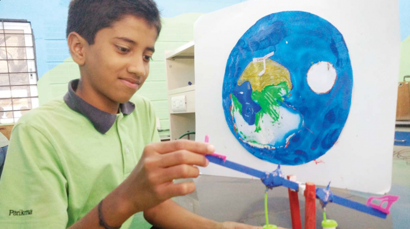 A child works on his project to be displayed at the Parikrma Science Festival in Bengaluru on Monday (Photo: DC)