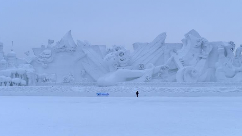 A man looks at snow sculptures during the Harbin International Ice and Snow Festival in northeast China's Heilongjiang province. (Photo: AFP)